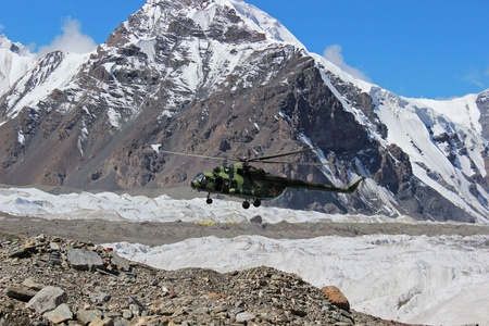 Soviet helicopter with climbers landing at Khan Tengri and Pobeda Peak base camp  (Kyrgyzstan ) Stock Photo - 17069783