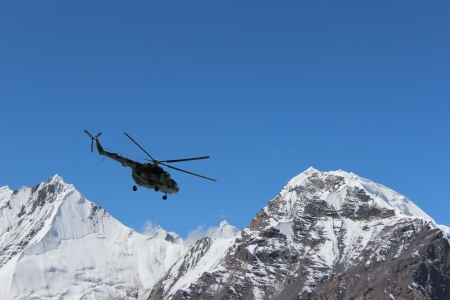 Soviet helicopter with climbers landing at Khan Tengri and Pobeda Peak base camp  (Kyrgyzstan ) Stock Photo - 17069772