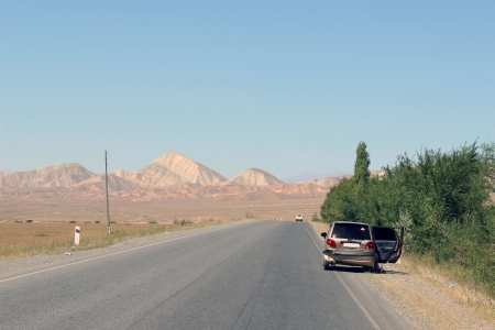 Car accident on road in Kyrgyzstan photo