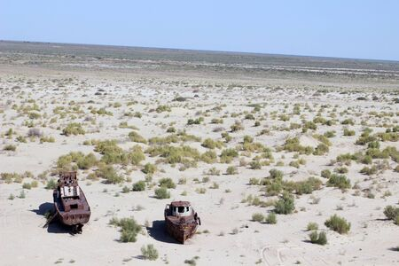 oppression: Destruction of the ships - The picture is made in Kara-Kalpak  Uzbekistan  in the dead city of Mujnak  On the given place 15 years ago there was Aral sea Destruction of the ship - The picture is made in Kara-Kalpak  Uzbekistan  in the dead city of Mujnak