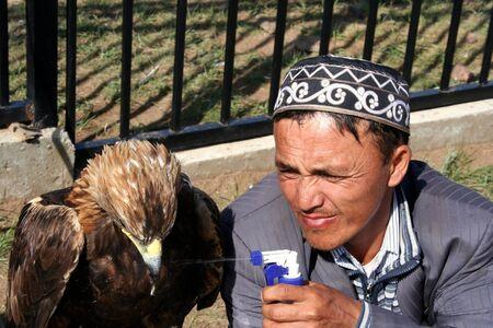 nomadism: Eaglehunter with hunting owl