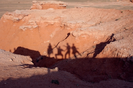 Bayan Zagh, The Flaming Cliffs of Mongolia s Gobi Desert  The shadows of people on the sand  photo