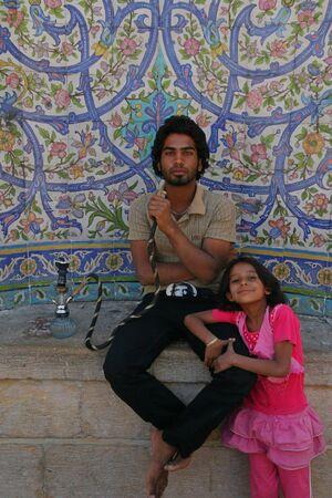 Boy and girl (Quran Gate in Shiraz, Iran )