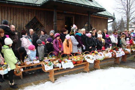 Blessing of food baskets at the church on easter (polish countryside).