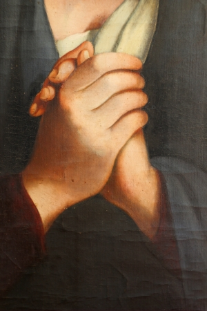 The Madonna in Sorrow  detail hands  , old oil paint  photo