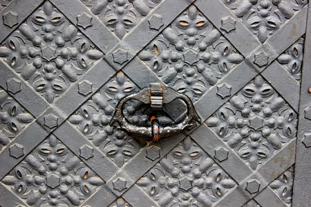 Old door with ornament in stone wall Stock Photo - 19446799