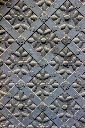 Old door with ornament in stone wall  Stock Photo - 19447407