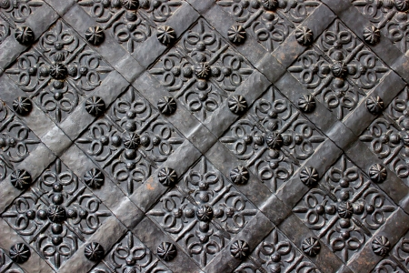 Old door with ornament in stone wall  Stock Photo - 19447414
