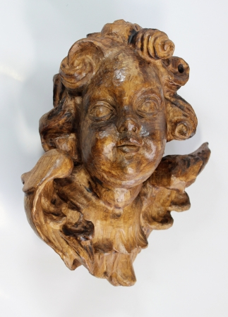 putto: hand-carved angel, putto  Stock Photo
