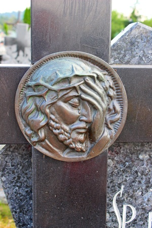 face of Jesus, sculpture in cemetery  photo