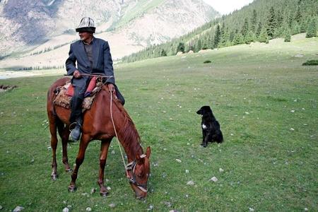 Kyrgyz horseman in Tien Shan mountains