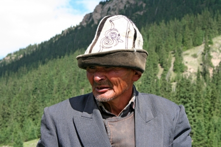 Kyrgyz horseman in Tien Shan mountains