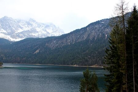 zugspitze mountain: Eibsee lake and Zugspitze, at 2,962 meters, is the highest peak of the Wetterstein Mountains as well as the highest mountain in Germany, Europe