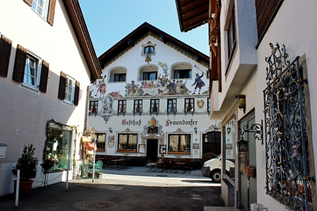 Decorated shop fronts and houses in Mittenwald with the Karwendel Mountains in the Bavarian Alps Germany Europe Editorial