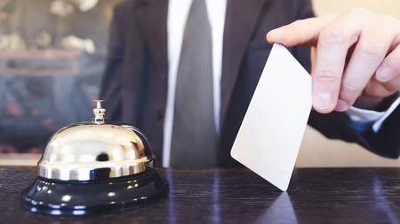 Hotel reception bell and blank room keycard