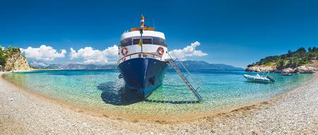 Tourist ship on the beach Stock Photo