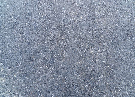 Rough granulated old asphalt texture with spots