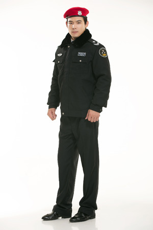 guarding: Security guard standing on white background