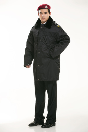 Policeman standing on white background photo