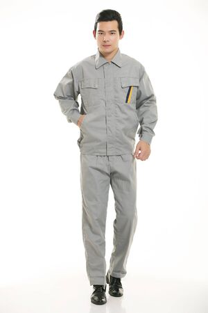 The young engineer various occupation clothing standing on white background photo