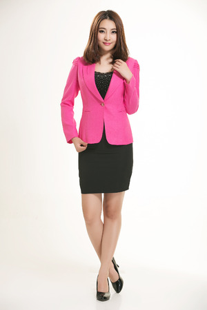chinese sex: Young Asian women wearing a suit in front of a white background