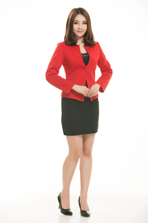 Young Asian women wearing a suit in front of a white background