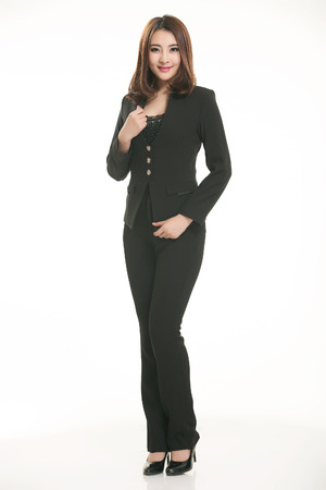wadded: Young Asian women wearing a suit in front of a white background