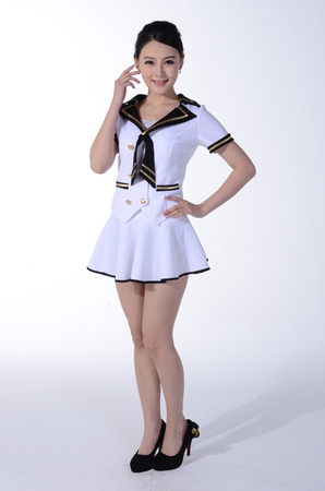 sprightly: Active girl wear costume in front of a white background
