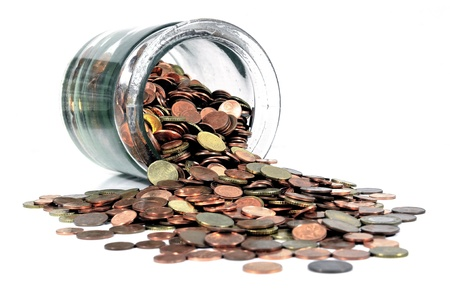 Glass money jar with spilling Euro cent coins