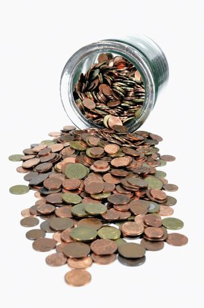 Glass money jar with spilling Euro cent coins photo