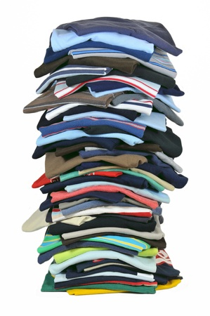 cotton dress: Large stack of multicolored t-shirts Stock Photo