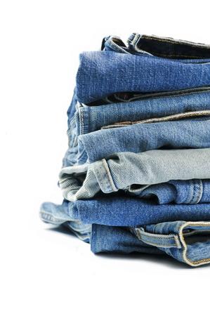 denim jeans: Stack of blue denim jeans