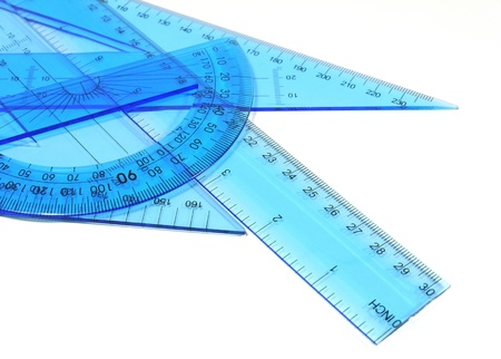 Technical tools - Set of blue ruler, triangle and protractor on white background  photo