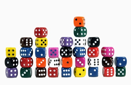 games of chance: Colorful casino dices in vertical stacks on white background
