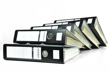 Pile of office ring binders with tax documents  Stock Photo