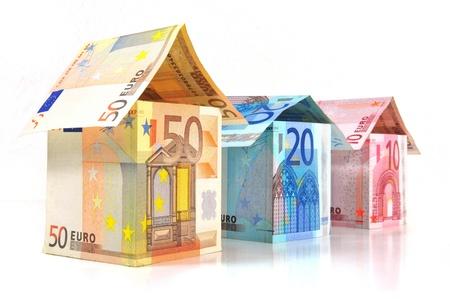 Euro huizen met bankbiljetten Stockfoto