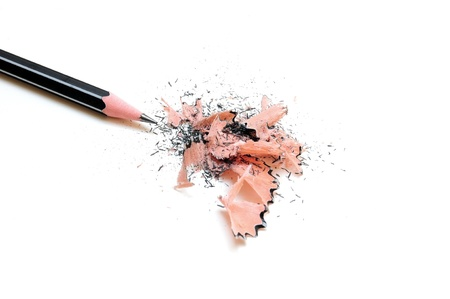 secretarial: Pencil with sharpening shavings on white background