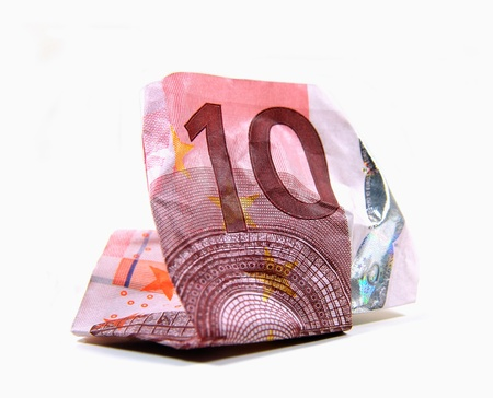 geld: Wrinkled 10 Euro banknote on white background Stock Photo