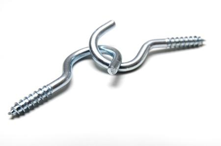 chrome vanadium: Two connected threaded hooks on white background  Stock Photo