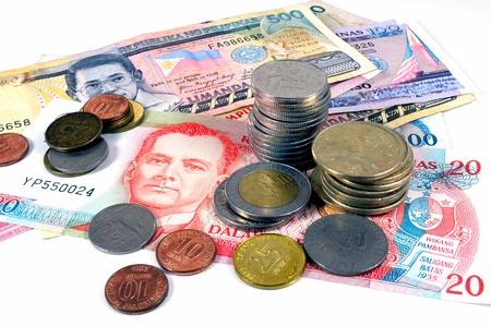 Filippijnen pisos op een stapel van verschillende bankbiljetten Stockfoto