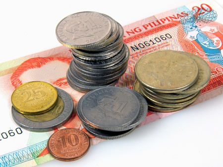 Philippines peso coins on a 20 piso banknote Stock Photo