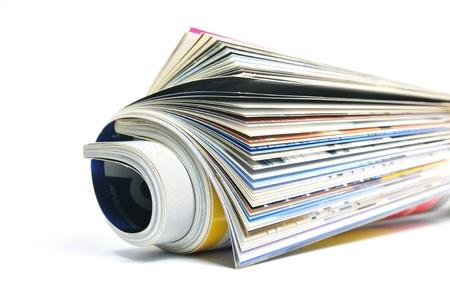 mag: Rolled gossip magazine over white background Stock Photo