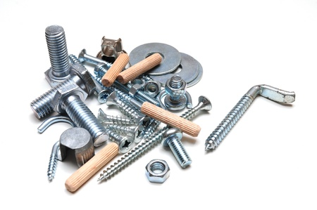 dowel: Group of screws,nuts and shims over white background  Stock Photo