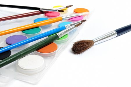 paintbox: Paintbox with water colors and paintbrushes Stock Photo