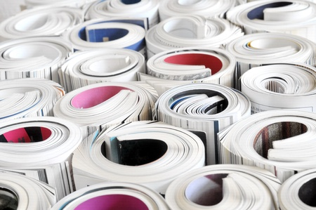 Bunch of rolled up magazines Imagens