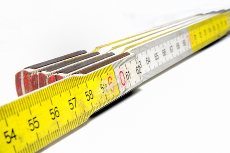 yardstick: Yellow and white colored yardstick on white background