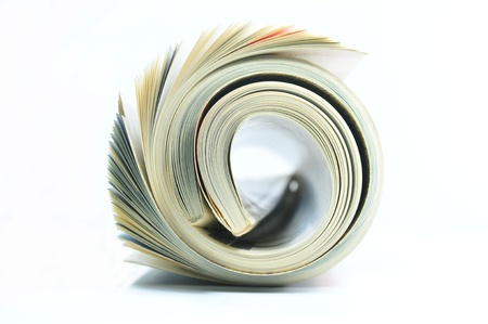 Rolled up magazine on white background