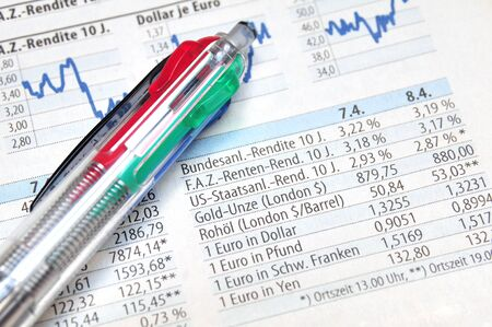 Ball point on top of a stock market report photo