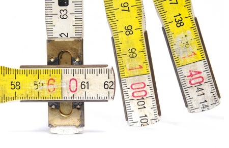 yardstick: Close up of yellow and white colored yardstick over white background