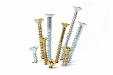 Group of drywall screws on white background